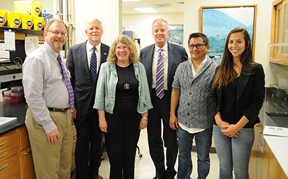 From left, Martin Draper, plant pathology department head; Richard B. Myers '65, then interim president; Barbara Valent, university distinguished professor; Sen. Jerry Moran; Christian Cruz '13, research assistant professor; and Giovana Cruppe, doctorate student from Brazil.
